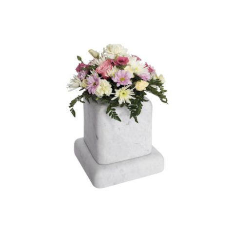 The cushioned edges to this marble vase create a gentle look.