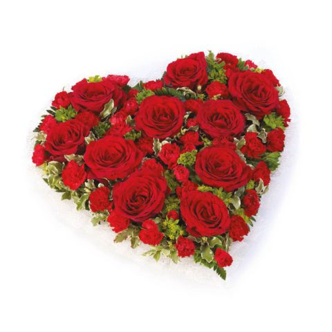 A traditional heart-shaped design including roses and spray carnations in rich red complemented by choice foliage.
