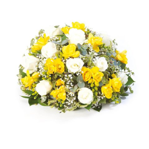 Roses and scented freesia are nestled amongst choice foliage in this classic posy design.