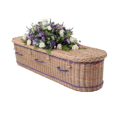 Somerset Willow curved end coffin in buff willow with purple band and woven purple handles.