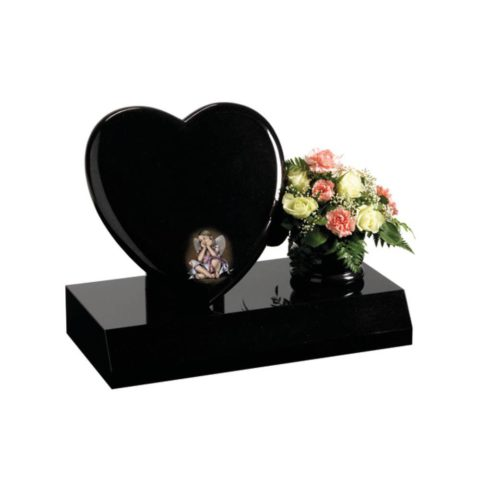 A beautiful Black granite heart shaped memorial with a polished rose bowl vase.